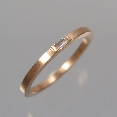 Diamantring 585 Roségold mit einem Diamant Baguette