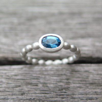925 Ring Silber mit petrol Topas Olivenring